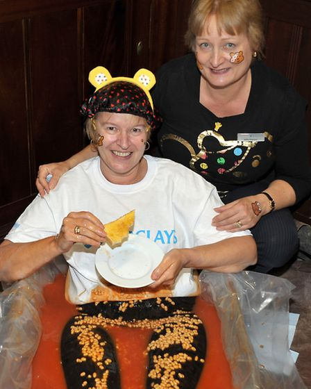 Carol Rushmer - cashier at Barclays Bank, Old Market, Wisbech , sitting in bath of baked beans for C