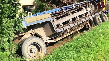 Scenes from the crash and recovery of trailer which left the main road through the Fen village and p