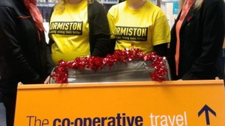 Lisa Howe and Jane Savage, of the March Anglia Co-operative Travel team, with Claire Whitmore and Li