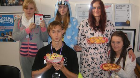 Students sold cakes in Onesies.