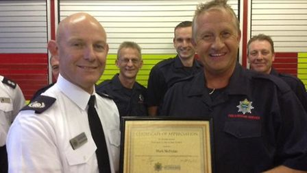 Mark Nicholas is presented with his 30-year certificate at Whittlesey Fire Station by Group Commande