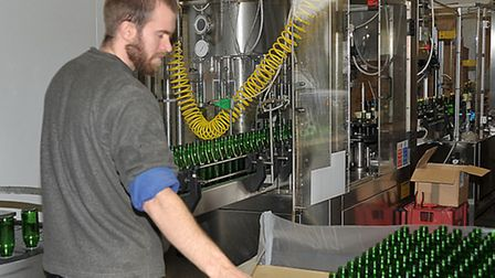 Open weekend at Watergull Orchards, North brink, Wisbech, James Fisher working in the bottling plant