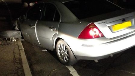 The car four men abandoned after it crashed into parked car