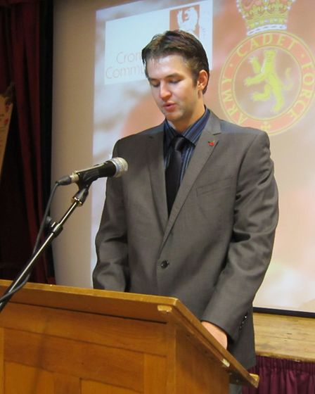 Former student Luke Watson delivers a moving speech.