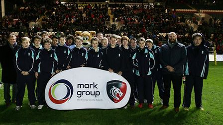 The Kings School group on the Welford Road pitch at half-time with Leicester Tigers player Rob Hawki