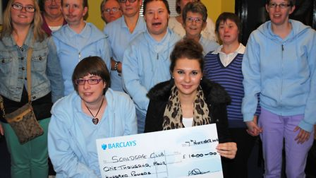 Melissa and Scaldgate Club members with the cheque.