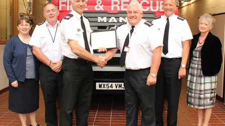 Station Commander Martin Boome, of Thorney, was presented his 30-year award with colleagues from the