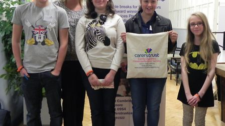 Four young carers who attend groups run by Carers Trust Cambridgeshire and Young Carers Lead Debbie