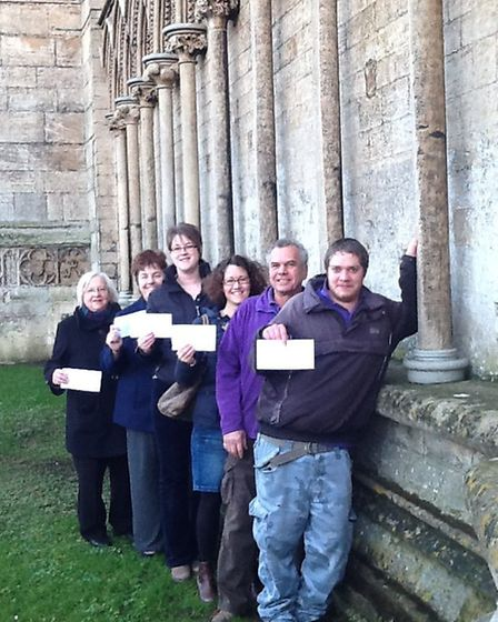 representatives of five worthy causes recieve their cheques