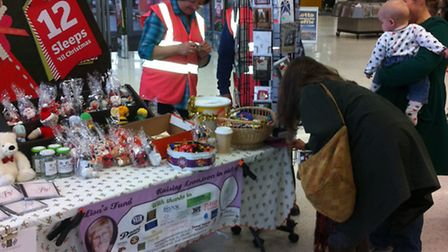 Pictured at Sainsbury's is fundraiser Jackie Watts with a Shopper.