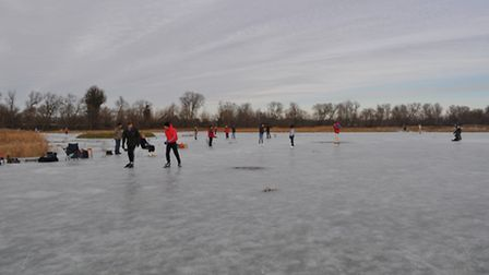 Skaters on the ice at Bury Fen on Boxing Day 2011.