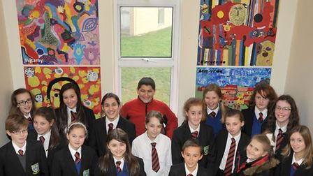 Soham village college. Students from the Gifted and Talented Art project with the Murals they create