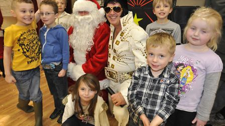 Santa and 'Elvis' with youngsters.