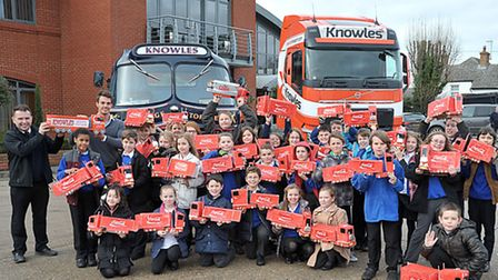 School children from Thomas Eaton presented model lorries to Knowles Transport, Wimblington. Left re