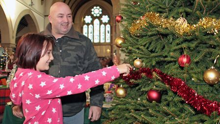 Scenes from St Peter's Church's annual Christmas tree festival. Pictures: BARRY GIDDINGS