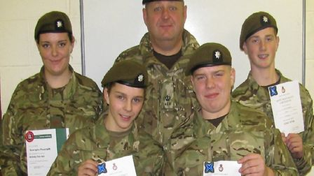 Major Geoff Hammond with four cadets.