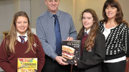 Cromwell Community College. Pupil/Staff bake off. Left: Winner Sophie Faunch, Paul Ward Science teac
