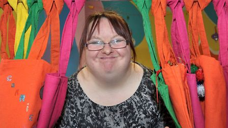 Mencap Artworks March. Anna Hankin with some of the bags she made.