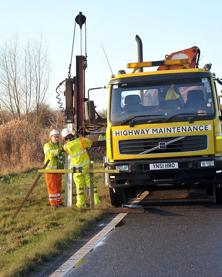 Barriers being installed on the North Bank river road Whittlesey. Picture: Steve Williams.
