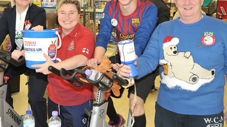 Tesco March. Indoor cycling challenge. Left: Laura Gill Abi Day, Lee Hawksford and Davie Rae.