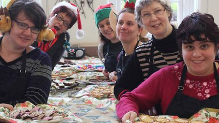 The team help create the spirit of Christmas at March's community cafe.