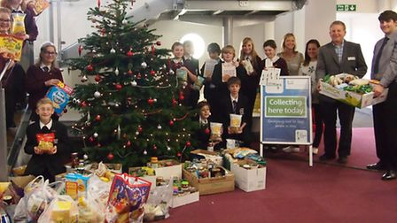 Pupils with the food they have collected for Chatteris Foodbank.