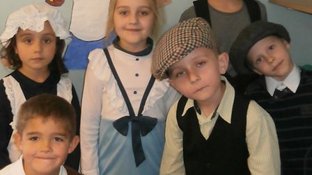Pupils in Victorian costumes.