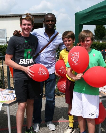Fabrice Muamba met Tom Jenner (left) and his brothers Ollie and Ben at Flitch Green Academy. Picture