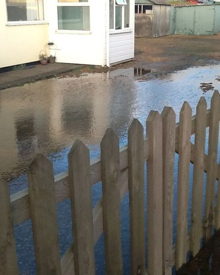Flooding at Westry and workmen trying to find the cause