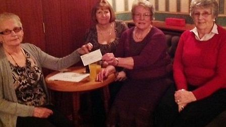 Scaldgate Club chairman Pam Potts MBE, secretary Pam Clifford and treasurer Ann Taylor receive a che