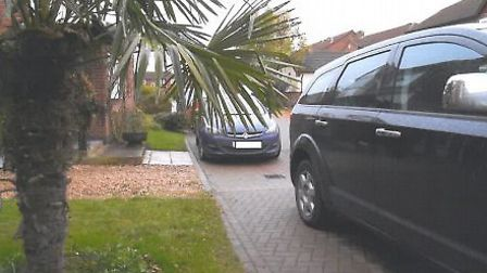 A car blocking Mr and Mrs Whitwell's driveway.