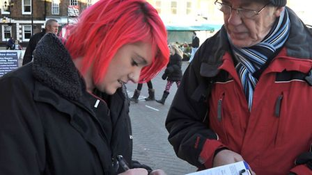 Wisbech petition protest against Hudson leisure centre name change. Georgie Constable signing Roger