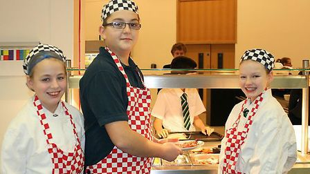 Students helped prepare food in the academy's kitchen.