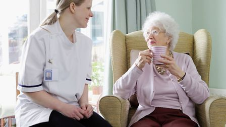 young nurse chatting with her patient