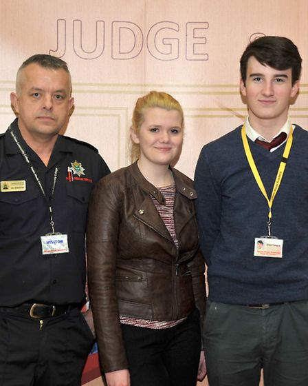 Neale Wade Academy. Road safety event. Left: Ady Bradshaw from Cambs fire and rescue service, Daniel