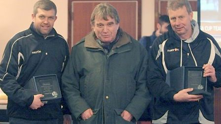 Ian Hart, left, and Steve Fallon, right, recieve their manager of the month awards from Sham chairma
