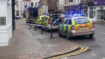 The pavement was cordoned off outside Lloyds Bank while emergency crews helped the woman.