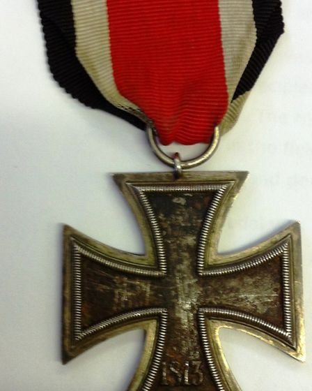 The German Iron Cross ripped from a uniform by Pte Day