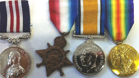 The medals awarded to Pte Day, including the rare 1914 Star (second left)