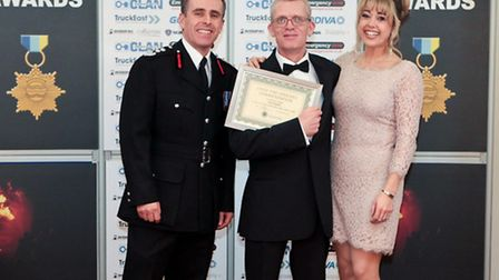 Alan Chapman recieves an award from Chief Fire Officer Graham Stagg