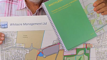 Bruce Smith of Whitacre Management Ltd shows the plans off for Sainsbury's supermarket, pub, country