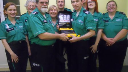 Paul Fedarb (L) and Tony Curd (R) with volunteers from the St John Ambulance Ely unit