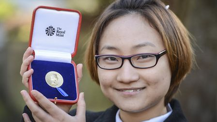 King Edward VII sixth form pupil Xuesong Yu with the medal presented to her by the Queen. Picture: M