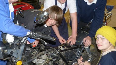Ely College students get to grips with a motorcycle