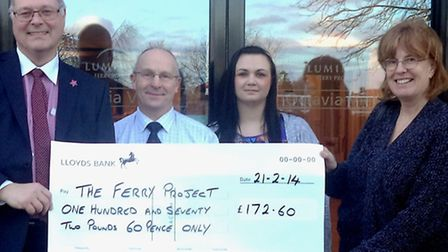 Sarah Atkin, Baz Figura and Sue Watson, colleagues from Fenmarc Produce Ltd, hand over a cheque for