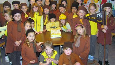 4th March Brownies dressed in uniforms over the time that the group has been running.