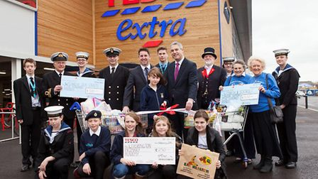 Nicole Cohen cuts the ribbon with MP Steve Barclay, members of Wisbech Sea Cadets and Wisbech & Dist