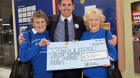 Eileen Wiles and Anita Barker, members of Wisbech & District Cancer Support Group, receive their gro