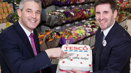 MP Steve Barclay, cutting a cake to celebrate the opening, and Kevin Chestnutt.