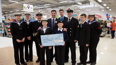 Wisbech Sea Cadets receive their groups cheque from store manager Kevin Chestnutt.